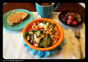 Salad with apple cider vinegar dressing, homemade bread, fruit salad, and Yogi Tea.